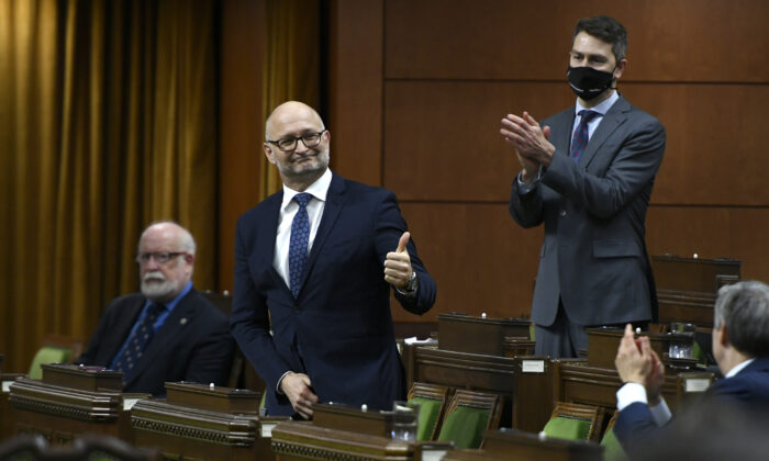 Minister of Justice David Lametti gives a thumbs up as he rises to vote in favour of a motion on Bill C-7, medical assistance in dying, in the House of Commons on Parliament Hill in Ottawa, Canada, on Dec. 10, 2020. (Justin Tang/The Canadian Press)
