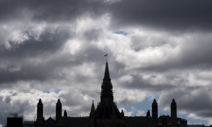 Clouds pass by the parliament buildings in Ottawa, Canada, on Aug. 19, 2020. (Adrian Wyld/The Canadian Press)