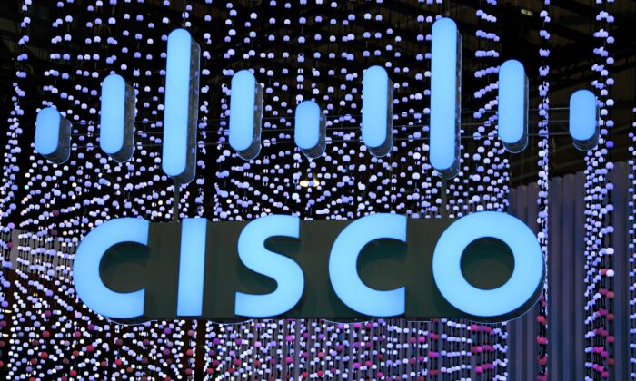 The Cisco Systems logo is displayed at the Mobile World Congress (MWC) in Barcelona, Spain on Feb. 25, 2019. (GABRIEL BOUYS/AFP via Getty Images)