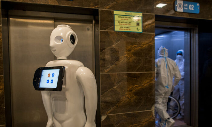 A robot designed to assist COVID-19 patients operates in the COVID-19 ward of a hospital in New Delhi, India, on Dec. 5, 2020. (Anindito Mukherjee/Getty Images)