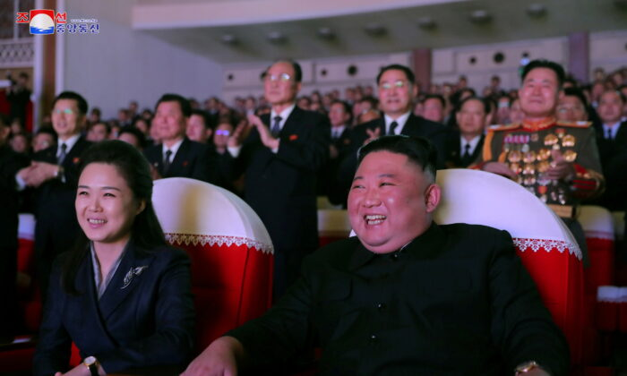 North Korean leader Kim Jong Un and his wife Ri Sol Ju watch a performance that commemorated the Day of the Shining Star, the birth anniversary of the late leader Kim Jong Il at the Mansudae Art Theatre in Pyongyang, North Korea in this undated photo released by North Korea's Korean Central News Agency (KCNA) on Feb. 17, 2021. (KCNA via Reuters)