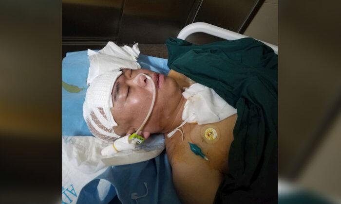 Falun Gong practitioner Yao Xiren at the ICU care unit at Longkou Hospital in Longkou city, Shandong Province, China. (Courtesy of Minghui.org)