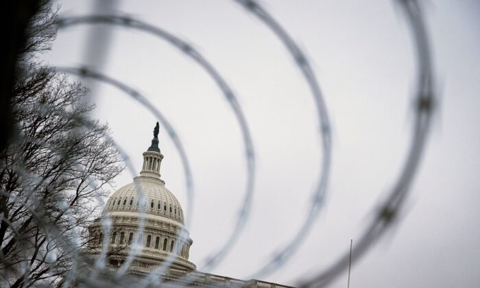 Barbed wire and security fencing surrounds the U.S. Capitol in Washington on Jan. 26, 2021. (Al Drago/Reuters)