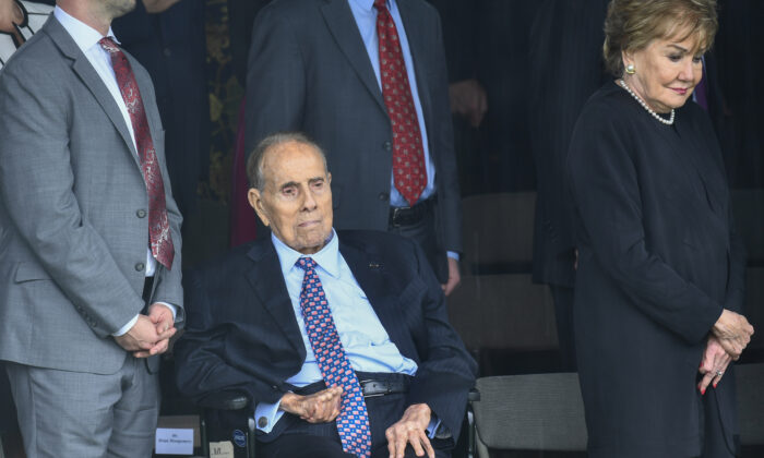 Former U.S. Sen. Bob Dole and his wife Elizabeth Dole wait as President Donald Trump arrives to participate in the Armed Forces Welcome Ceremony in honor of the Twentieth Chairman of the Joint Chiefs of Staff at Summerall Field, Joint Base Myer-Henderson Hall, Va., on Sept. 30, 2019. (Brendan Smialowski/AFP via Getty Images)