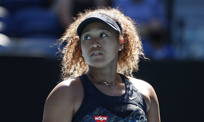 Naomi Osaka of Japan  looks on in her Women's Singles Semifinals match against Serena Williams of the United States during day 11 of the 2021 Australian Open at Melbourne Park in Melbourne, Australia on Feb. 18, 2021. (Daniel Pockett/Getty Images)