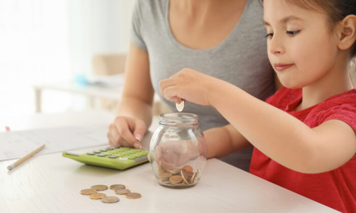 Use a four-jar money management system to help your children use their math skills while developing a habit of managing their money before they spend it. (Pixel-Shot/Shutterstock)