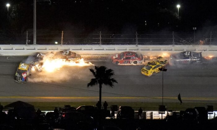 Racers crash during the last lap in the NASCAR Daytona 500 auto race at Daytona International Speedway, in Daytona Beach, Fla., on Feb. 15, 2021. (Chris O'Meara/AP Photo)