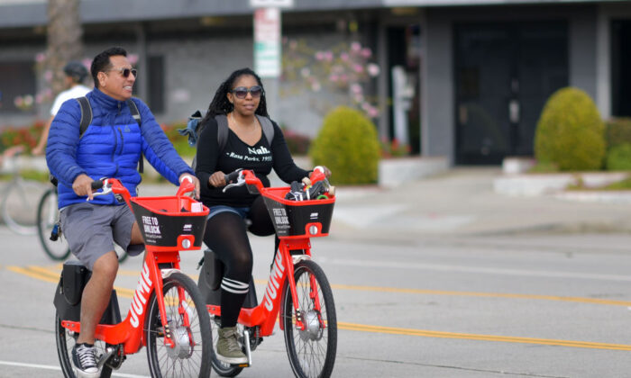 People ride Uber's JUMP e-bikes in car-free streets during a CicLAvia event in Culver City on March 3, 2019.  CicLAvia is a non-profit organization that hosts events where people can bike, walk, skate and stroll on car-free streets. (Chris Delmas/AFP via Getty Images)
