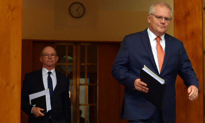 CANBERRA, AUSTRALIA - FEBRUARY 05: Prime Minister Scott Morrison (right) arrives with Chief Medical Officer Paul Kelly (left) during a press conference in the Prime Minister's Courtyard on February 05, 2021 in Canberra, Australia. Prime Minister Morrison and national cabinet met this morning to discuss Economy and COVID-19 hotel quarantine arrangements. Victoria has reported no new Covid-19 cases as South Austraila Premier Steven Marshall confirmed that the hard border arrangement with WA is being removed immediately. (Photo by Sam Mooy/Getty Images)