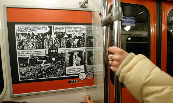 """Part of a serial shows up on the wall of a Budapest metro train March 4, 2005 as an exhibition opened today in the Budapest  underground about the work of an artist who has translated the horror of the Holocaust into a comic book novel. Pictures from Art Spiegelman's """"Maus,"""" in which the New York-based artist draws Jews as mice and Germans as cats in a black-and-white interpretation of his own parents' survival of the Auschwitz death camp, have gone on view on two metro lines. (Attila Kisbenedek/AFP via Getty Images)"""