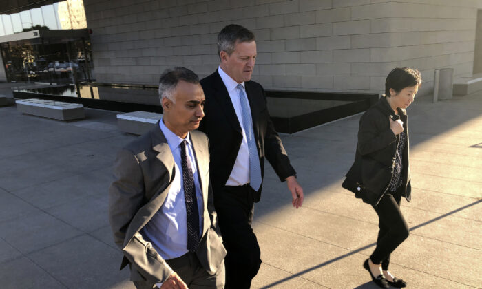 Imaad Zuberi, left, leaves the federal courthouse with his attorney Thomas O'Brien, second from left, in Los Angeles on Friday, Nov. 22, 2019. Zuberi pleaded guilty to funneling donations from foreigners to U.S. political campaigns.  (Brian Melley/AP Photo)