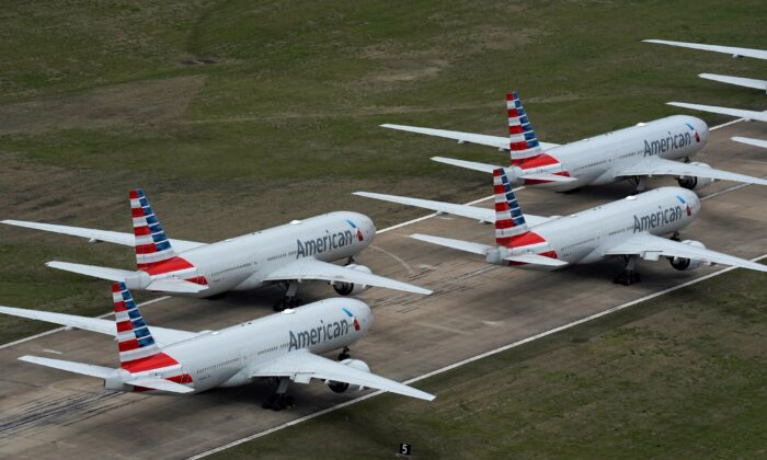 American Airlines passenger planes crowd a runway, at Tulsa International Airport in Tulsa, Oklahoma, on March 23, 2020. (Nick Oxford/Reuters, File Photo)