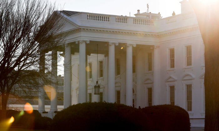 A general view of the sun rising behind the White House in Washington, on Jan. 22, 2021. (Jonathan Ernst/Reuters)