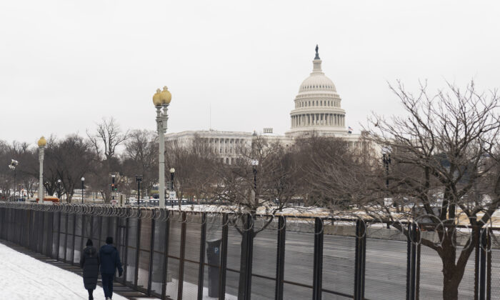 The U.S. Capitol is seen behind the metal security fencing around the U.S. Capitol in Washington on Feb. 18, 2021. (Manuel Balce Ceneta/AP Photo)