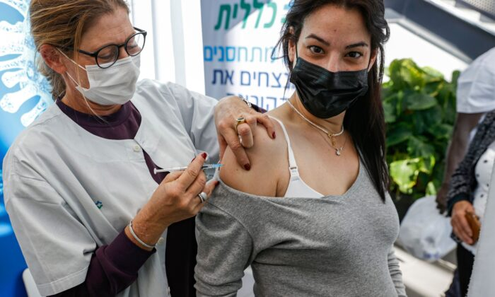 A health worker administers a dose of the Pfizer-BioNtech COVID-19 vaccine to a pregnant woman at Clalit Health Services, in Israel's Mediterranean coastal city of Tel Aviv on Jan. 23, 2021. (Jack Guez/AFP via Getty Images)