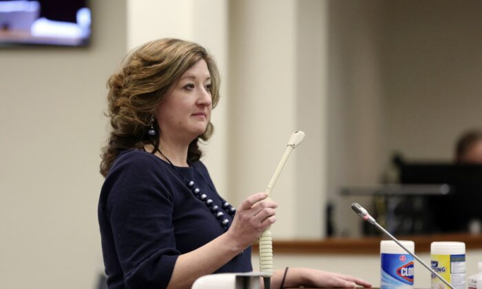 Melissa Anne Cunningham-Sereque shows the wand used to do ultrasound on pregnant women during a South Carolina House subcommittee hearing on an abortion bill in Columbia, S.C., on Feb. 3, 2021. (Jeffrey Collins/AP Photo)