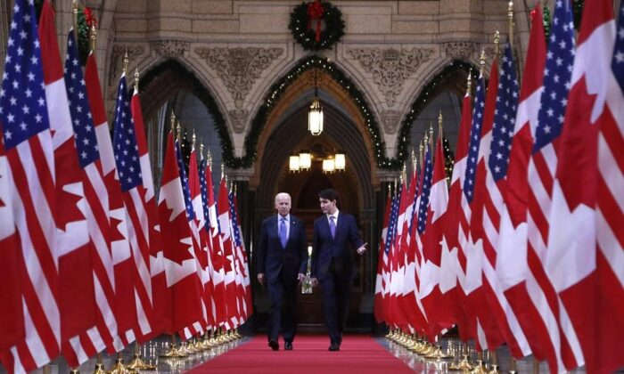 Prime Minister Justin Trudeau and then-U.S. Vice-President Joe Biden walk down the Hall of Honour on Parliament Hill in Ottawa on Dec. 9, 2016.  (Patrick Doyle/The Canadian Press)