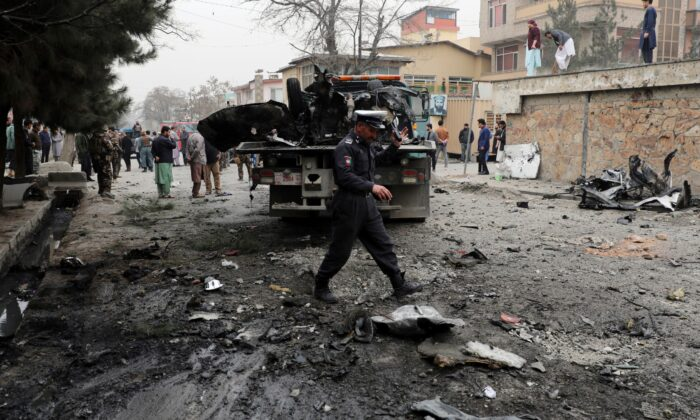 Security personnel inspect the site of a bomb attack in Kabul, Afghanistan, Saturday, Feb. 20, 2021. (Rahmat Gul/AP)