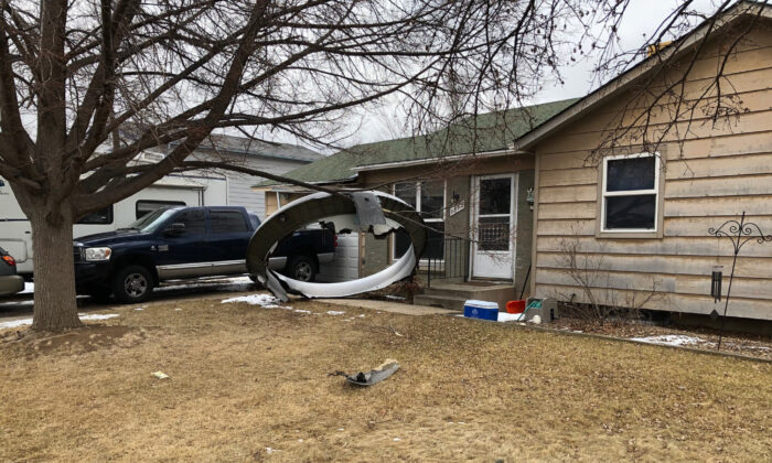 Debris is scattered in the front yard of a house at near 13th and Elmwood,  in Broomfield, Colo., on Feb. 20, 2021. 