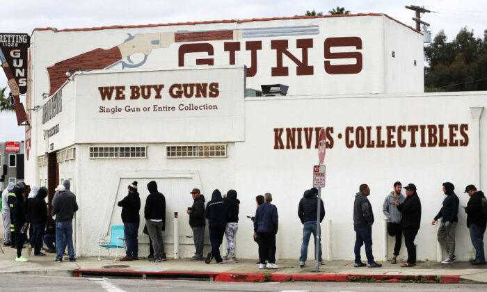 People stand in line outside the Martin B. Retting gun store in Culver City, Calif., on March 15, 2020. (Mario Tama/Getty Images)
