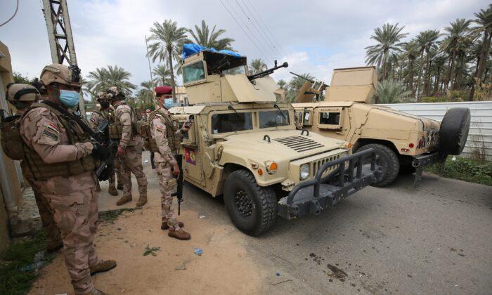 Iraqi forces search the area in Tarmiyah, 35 kilometres (20 miles) north of Baghdad, on Feb. 20, 2021. (Ahmad Al-Rubaye/AFP via Getty Images)