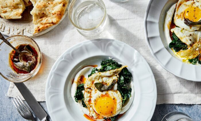 Inspired by a traditional Turkish dish called cilbir, these crispy fried eggs are served over lemony Greek yogurt and garlicky greens, and topped with a drizzle of smoky sage butter. (Kristin Teig/TNS)