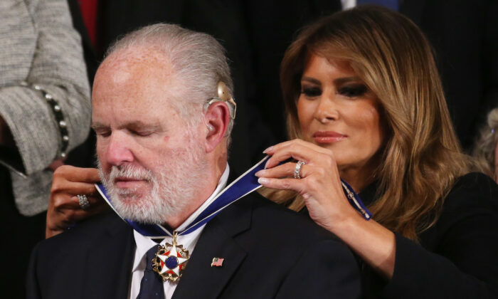 Radio personality Rush Limbaugh reacts as First Lady Melania Trump gives him the Presidential Medal of Freedom during the State of the Union address in the chamber of the U.S. House of Representatives in Washington on Feb. 4, 2020. (Mario Tama/Getty Images)