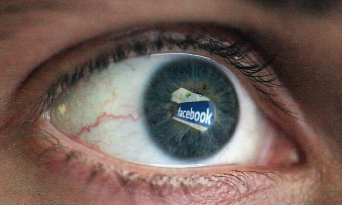 In this photo illustration the Social networking site Facebook is reflected in the eye of a man in London on March 25, 2009. (Dan Kitwood/Getty Images)