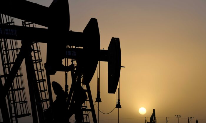 Pump jacks operate at sunset in Midland, Texas, on Feb. 11, 2019. (Nick Oxford/Reuters)