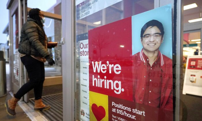 A passer-by walks past a sign advertising job opportunities while entering a Target store in Westwood, Mass., on Feb. 9, 2021. (Steven Senne/AP Photo)