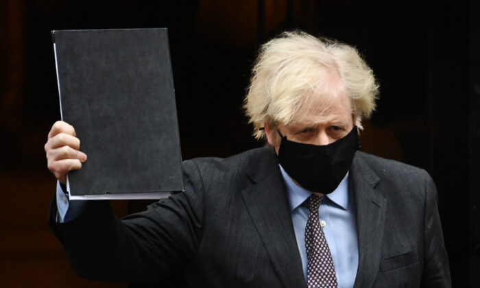 UK Prime Minister Boris Johnson leaves Downing Street on his way to the House of Commons to deliver a statement on the government's four-step plans to release England from the current lockdown restrictions, on Feb. 22, 2021. (Leon Neal/Getty Images)