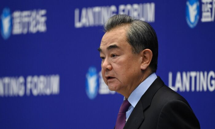 Chinese Foreign Minister Wang Yi speaks at the Lanting Forum on China-US relations in Beijing, China on Feb. 22, 2021. (Greg Baker/AFP via Getty Images)