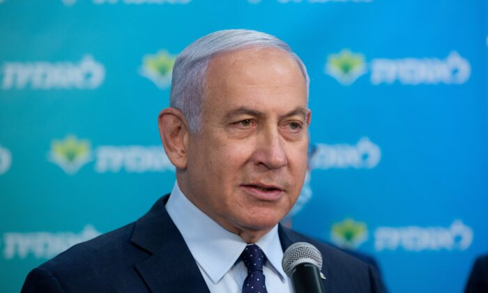 Israeli PM Benjamin Netanyahu speaks during a visit to Leumit Health Care Services vaccination facility in Jerusalem where he meets the 4,000,000 person who had been vaccinated in Israel, Feb. 16, 2021. (Alex Kolomoisky/Pool/Reuters)