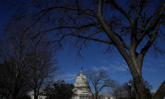 Barbed wire and security fencing surrounds the U.S. Capitol in Washington, on Feb. 5, 2021. (Sarah Silbiger/Reuters)