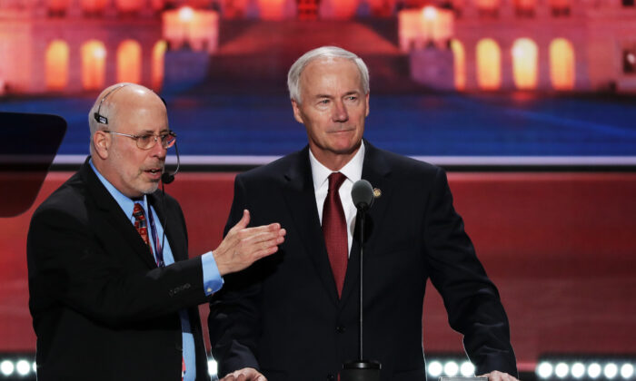 Arkansas Governor Asa Hutchinson stands on stage prior to the start of the second day of the Republican National Convention at the Quicken Loans Arena in Cleveland, Ohio, on July 19, 2016. (Alex Wong/Getty Images)
