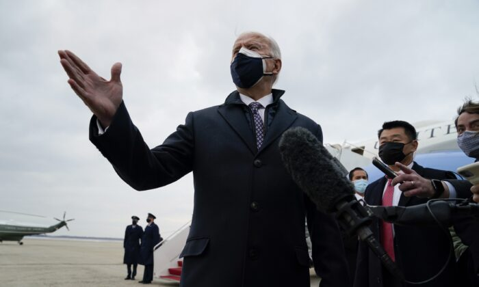 President Joe Biden speaks to reporters after exiting Air Force One on Andrews Air Force Base, Md., on Feb. 19, 2021. (Evan Vucci/AP Photo)