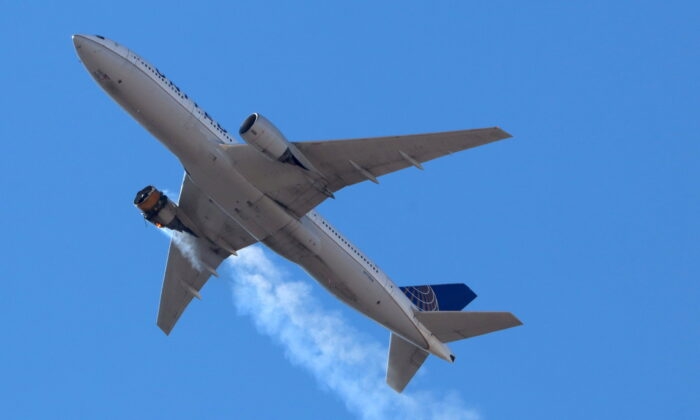 United Airlines flight UA328 returns to Denver International Airport with its starboard engine on fire after it called a Mayday alert, over Denver, Colo., on Feb. 20, 2021. (Hayden Smith/@speedbird5280 via Reuters)