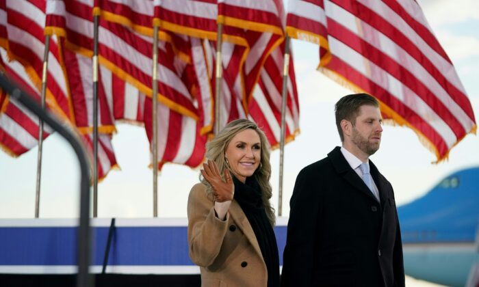 Eric Trump and his wife Lara arrive for outgoing U.S. President Donald Trump and First Lady Melania Trump's farewell at Joint Base Andrews in Maryland on Jan. 20, 2021. (Alex Edelman/AFP via Getty Images)