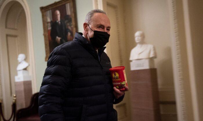 Senate Majority Leader Chuck Schumer (D-N.Y.) walks on Capitol Hill in Washington on Feb. 12, 2021. (Brendan Smialowski/AFP via Getty Images)
