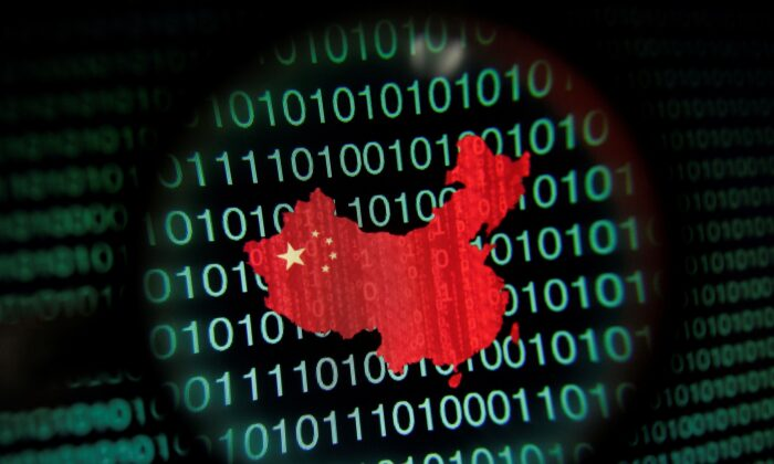 A map of China is seen through a magnifying glass on a computer screen showing binary digits. (Edgar Su/File Photo/Reuters)