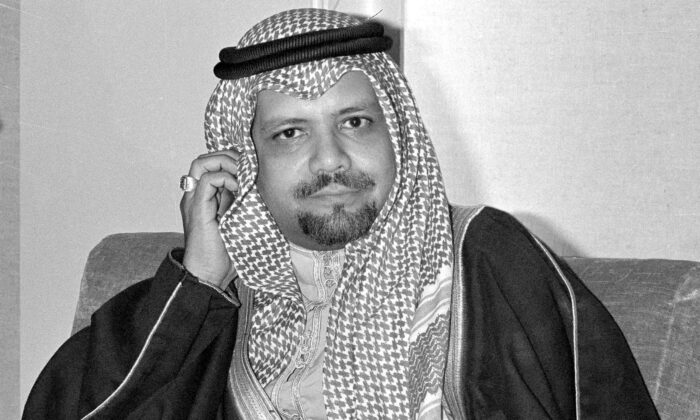 In this file photo, Saudi Oil Minister Ahmed Zaki Yamani listens to newsmen's questions during a news conference at Doha, Qatar, after he arrived to attend OPEC meeting, on Dec. 14, 1976.  (AP Photo, File)