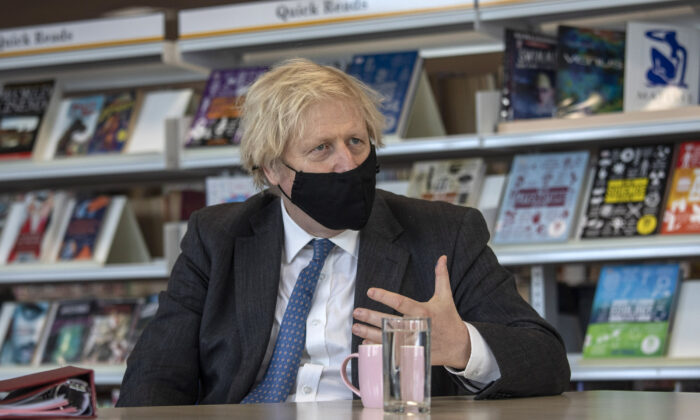 Prime Minister Boris Johnson meets teachers in the library as he visits Sedgehill School in southeast London, UK, on Feb. 23, 2021. (Jack Hill - WPA Pool/Getty Images)