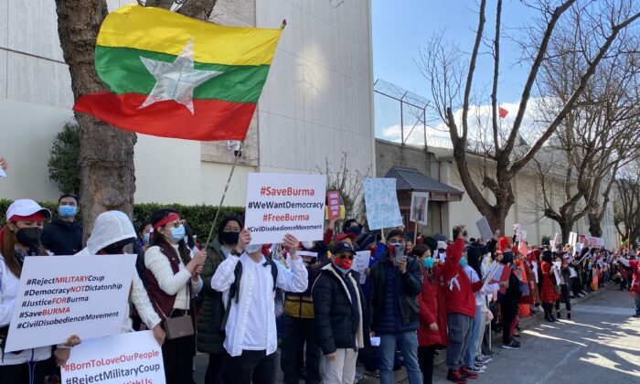 Protesters hold signs outside the Chinese Consulate in San Francisco on Feb. 20 to call for an end to the Chinese regime's support for the Burmese military coup. (Nancy Han/The Epoch Times)