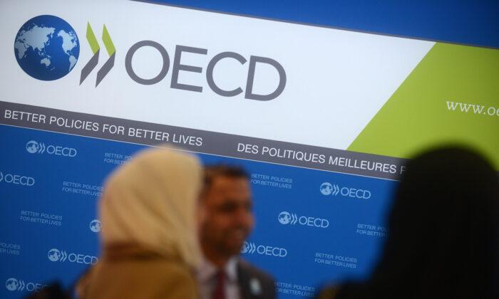 In this file photo, guests arrive at OECD headquarters in Paris on Nov. 27, 2013. (Antoine Antoniol/Getty Images)