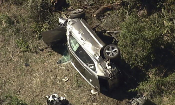 A vehicle rest on its side after a rollover accident involving golfer Tiger Woods along a road in the Rancho Palos Verdes section of Los Angeles on Feb. 23, 2021. (KABC-TV via AP)