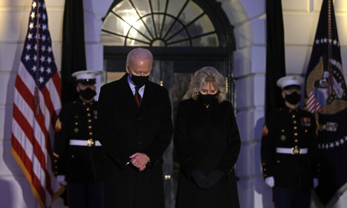 President Joe Biden and first lady Jill Biden participate in a moment of silence at sundown in the South Portico of the White House in Washington, D,C., on Feb. 22, 2021. (Alex Wong/Getty Images)