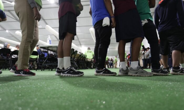 Immigrants line up in the dining hall at the U.S. government's newest holding center for migrant children in Carrizo Springs, Texas, on July 9, 2019. (Eric Gay/AP Photo)