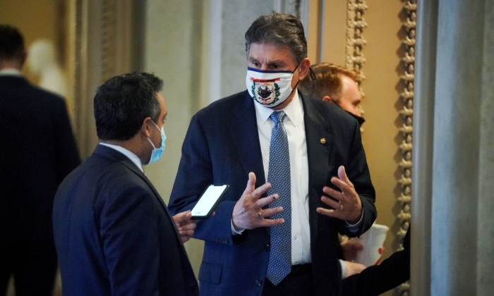Democratic Sen. Joe Manchin speaks to a reporter outside the Senate Chamber on Feb. 13, 2021. (Greg Nash/pool/AFP via Getty Images)