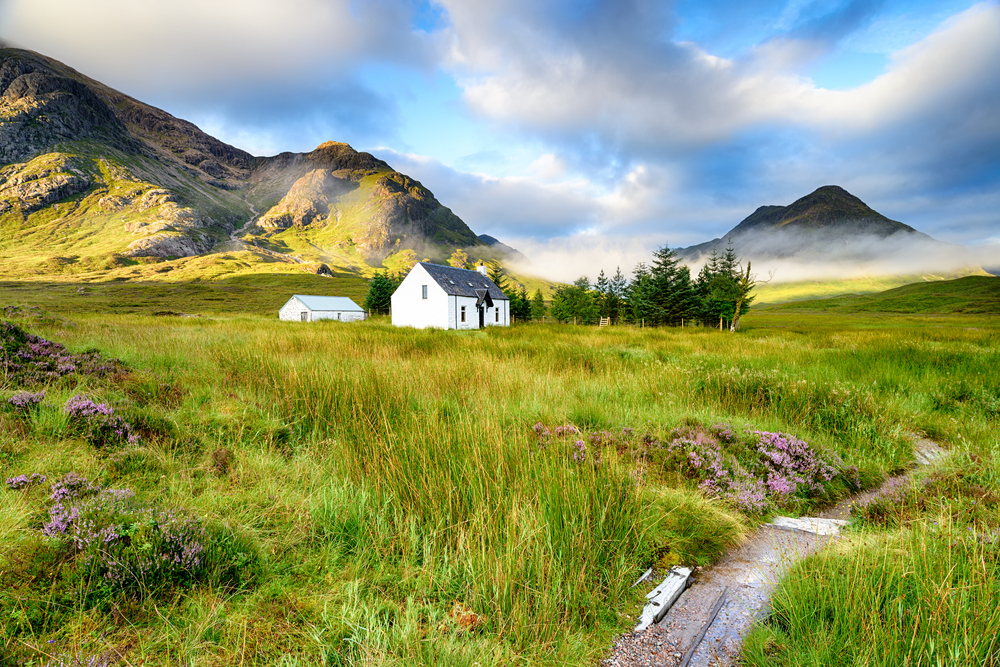 A,Picture,Postcard,Cottage,At,Glencoe,In,The,Scottish,Highlands