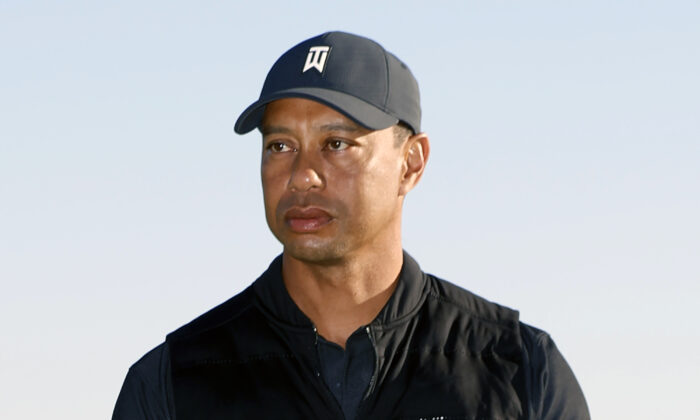 Tiger Woods looks on during the trophy ceremony on the practice green after the final round of the Genesis Invitational golf tournament at Riviera Country Club, in the Pacific Palisades area of Los Angeles, Calif., on Feb. 21, 2021. (Ryan Kang/AP Photo)